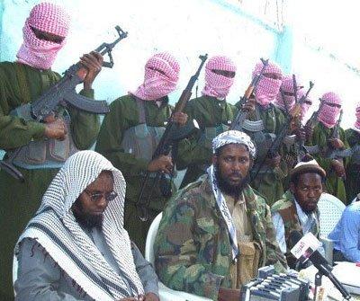 Fuad Mohamed Khalaf (in the middle in camouflage jacket)