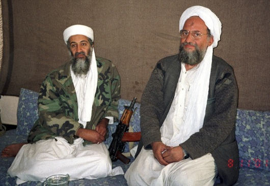 Osama bin Laden (L) sits with his eventual successor Ayman al-Zawahiri