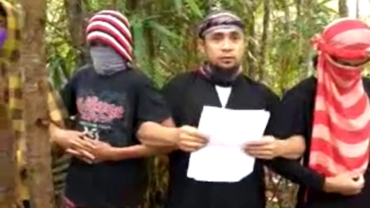 Abu Sayyaf pledging allegiance to the Islamic State