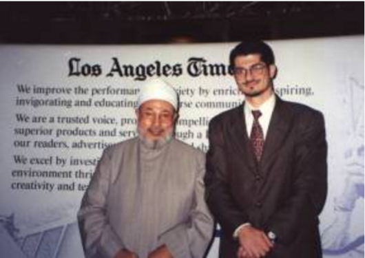 "Hussam Ayloush posing with the Muslim Brotherhood's Sheikh Youssef al Qaradawi. It is worth noting that Qaradawi has been banned from traveling to the US, the UK and France for his ties to ""extremism."" He has also endorsed female genital mutilation and approved Jihadists fighting the US in Iraq and attacking civilians in Israel"