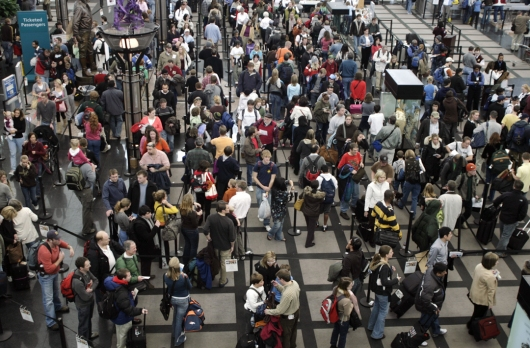 Travelers queue up at the security checkpoint in Denver International Airport in Denver, Saturday, Dec. 23, 2006. (AP Photo/David Zalubowski)