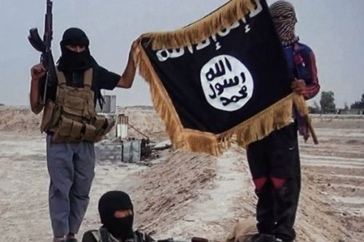 Militants-of-the-Islamic-State-of-Iraq-and-the-Levant-ISIL-posing-with-the-trademark-Jihadists-flag